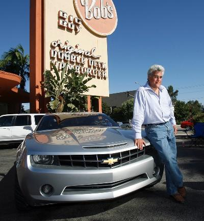 Leno poses with one of his 16,784 (est.) cars